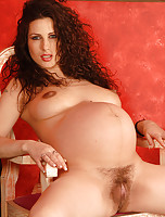 Gorgeous and pregnant soon to be MILF looks hot as hell in here