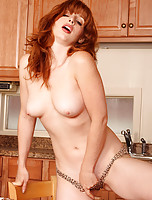 32 year old redhead from AllOver30 enjoys her coffee naked