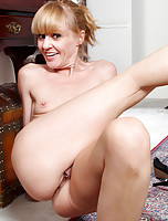 Anilos Josie slips off her business suit and showa her natural blonde landing strip