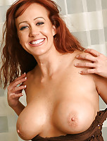 Hot MILF Bailey strips and plays with her massive mams