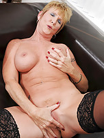 Sexy blonde mature granny fingers her pierced pussy while wearing stockings