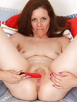 Lora toys her mature pussy and has a raging orgasm